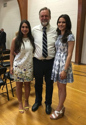 William Probst at a school event with former students Samantha Chalet (left) and Sabeene Khalil.