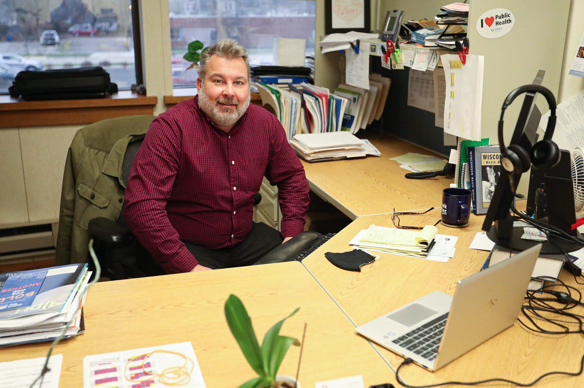 Winnebago County health officer Doug Gieryn works at his desk Wednesday, Nov. 25, 2020, at the Winnebago County Public Health building at 112 Otter St. in Oshkosh, Wis.