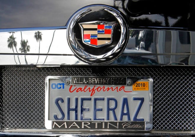 """In this May 24, 2010, file photo, an SUV with a personalized license plate is seen in Beverly Hills, Calif. A federal judge said Tuesday, Nov. 24, 2020, that California can't ban vanity license plates it considers """"œoffensive to good taste and decency"""" because that violates freedom of speech."""
