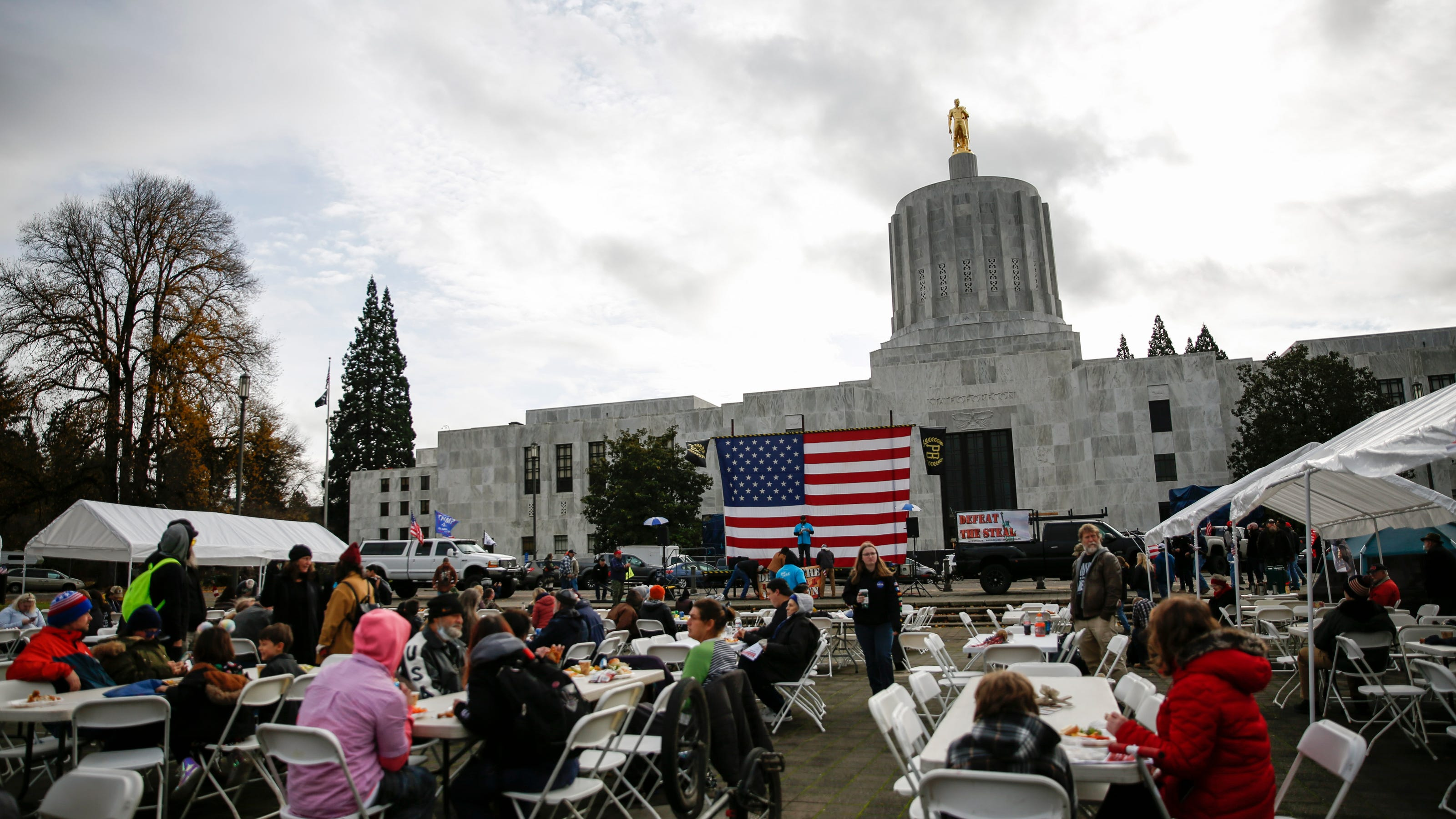 Oregon State Capitol protesters eat Thanksgiving meal, defy Gov. Kate Brown's 'freeze' - Statesman Journal