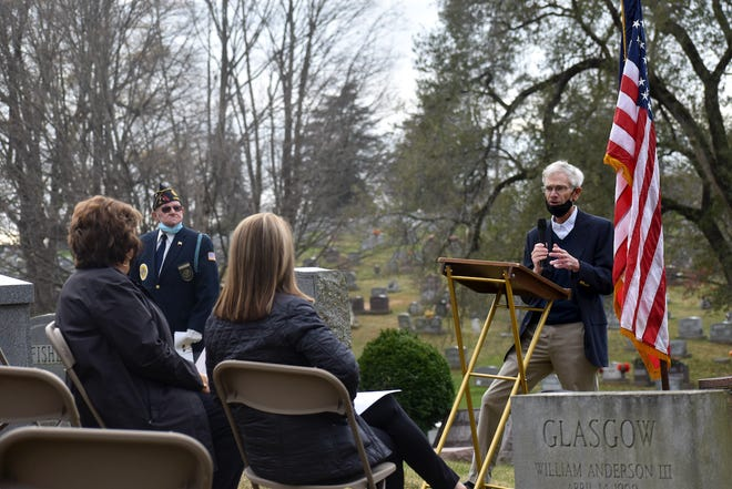 Tom Erskine speaks to those gathered at Victor Lee Ellinger's graveside on Tuesday, 50 years after the Staunton native was killed in Vietnam.