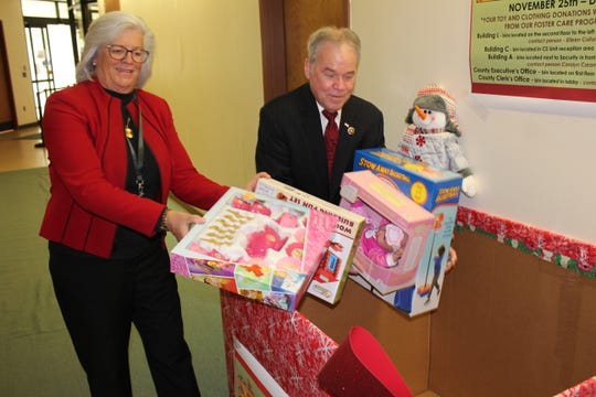 Joan Silvestri, Rockland's social services commissioner, and County Executive Ed Day seen at the start of the county's 2019 toy and clothing drive.