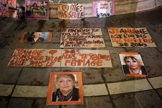 Posters of women victims of domestic violence are pictured at the Saint Michel fountain Wednesday, Nov. 25, 2020 in Paris. With domestic violence on the rise amid the pandemic, activists are holding protests Wednesday from France to Turkey and world dignitaries are trying to find ways to protect millions of women killed or abused every year by their partners.