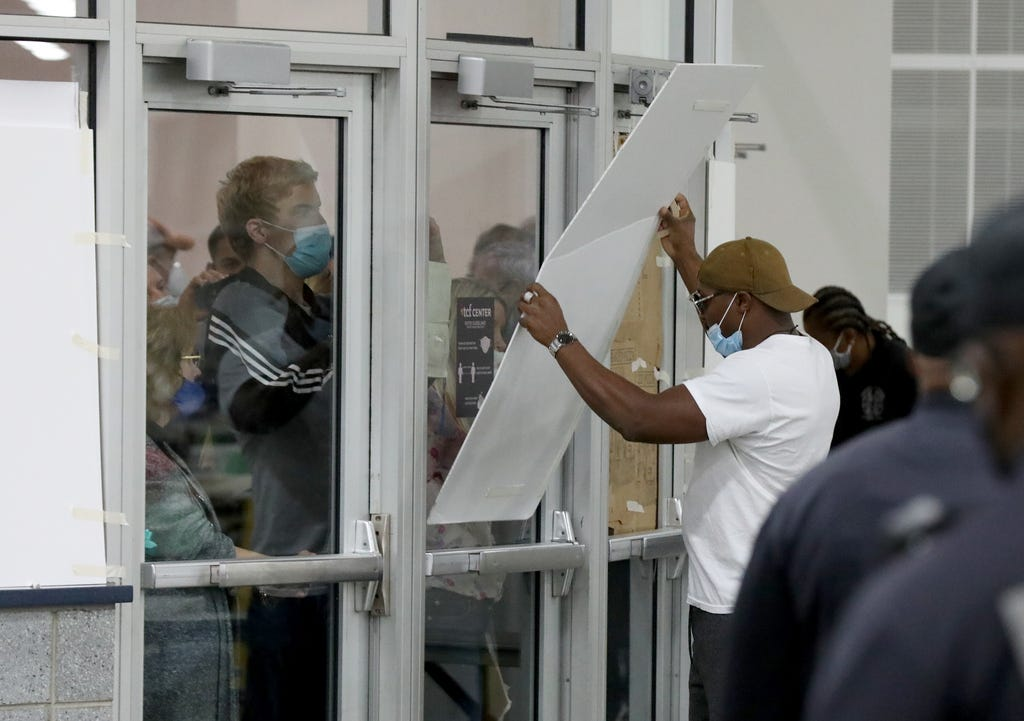 Large pieces of cardboard were taped up to prevent people from taking photos and videos of the ballot counting area at the TCF Center in Detroit on Wednesday, Nov. 4, 2020.