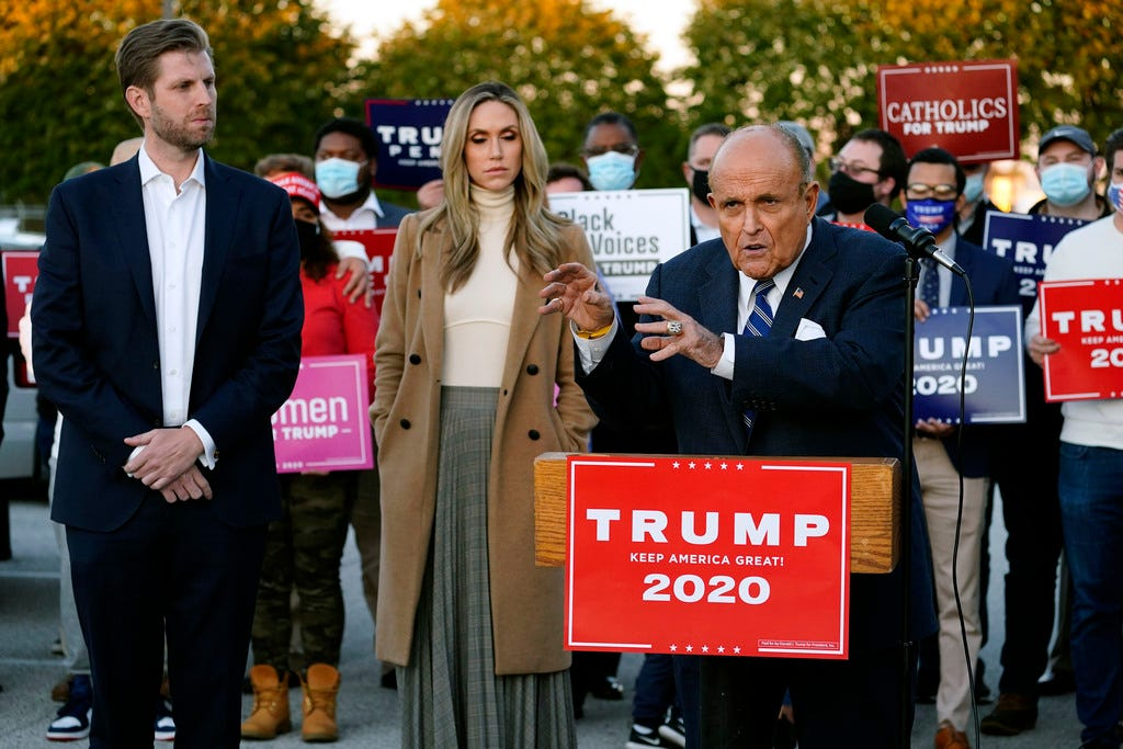 Rudy Giuliani, a lawyer for President Donald Trump, speaks during a news conference on legal challenges to vote counting in Pennsylvania on Nov. 4 in Philadelphia. At left are Eric Trump, the president's son, and his wife, Lara.