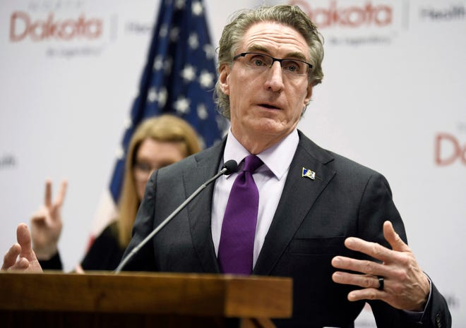 FILE - In this April 10, 2020, file photo, North Dakota Gov. Doug Burgum speaks at the state Capitol in Bismarck, N.D. (Mike McCleary/The Bismarck Tribune via AP, File) ORG XMIT: NDBIS501
