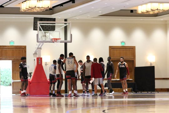 The New Mexico State University menÕs basketball team practices inside the Arizona Grand Resort & Spa in Phoenix.
