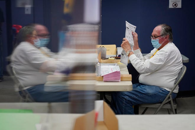 In this Oct. 31, 2020, county employees process mail-in ballots at a Clark County election department facility in Las Vegas.