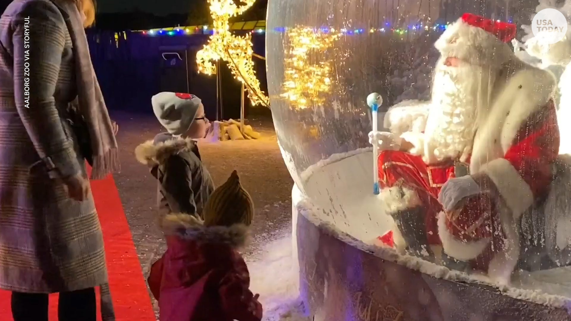 Santa greets children from inside snow globe to practice social distancing