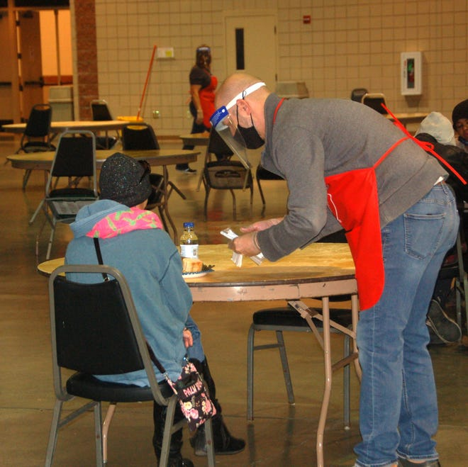 A volunteer serves a guest during Thursday's Community Fellowship Lunch at the Amarillo Civic Center.