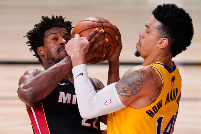 The Lakers' Danny Green, right, and the Heat's Jimmy Butler battle for the ball during the NBA Finals.