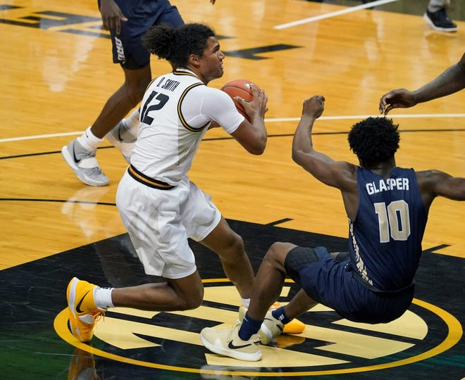 Missouri guard Dru Smith (12) shoots and is fouled by Oral Roberts guard RJ Glasper (10) during a game Wednesday at Mizzou Arena.
