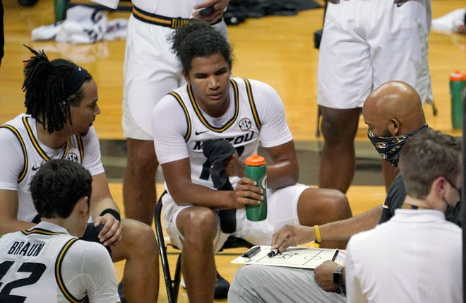 Missouri head men's basketball coach Cuonzo Martin, right, talks with players in a timeout during a game against Oral Roberts on Wednesday at Mizzou Arena.