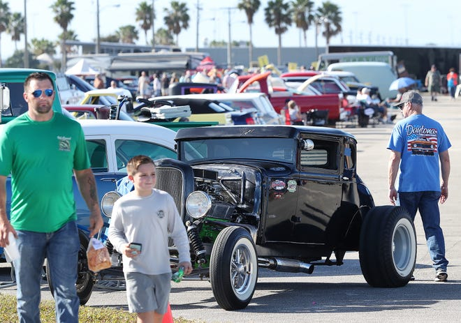 Car lovers check out the rides at the annual Turkey Run classic-car show over Thanksgiving weekend at Daytona International Speedway. Despite the car show and the long holiday weekend, business at area hotels fell short of matching last year's level, according to many hoteliers.