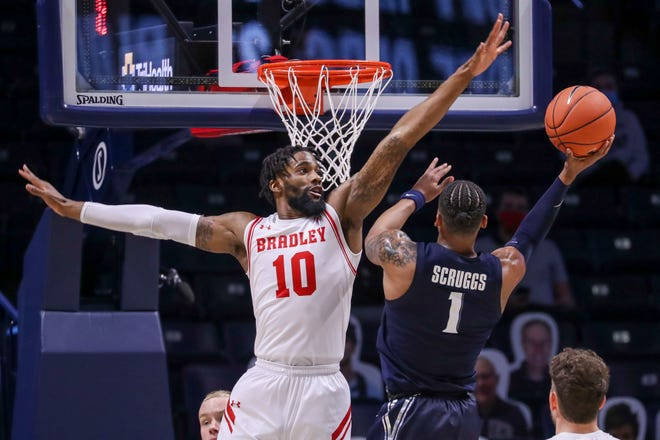 Nov 26, 2020; Cincinnati, Ohio, USA; Xavier Musketeers guard Paul Scruggs (1) goes up for a basket against Bradley Braves forward Elijah Childs (10) in the second half at Cintas Center. Mandatory Credit: Katie Stratman-USA TODAY Sports
