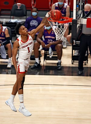 Texas Tech Terrence Shannon Jr. (1) dunks the ball during the game against Northwestern State, Wednesday, Nov. 25, 2020, at United Supermarkets Arena in Lubbock, Texas.
