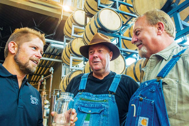 Greg Eidam, left, Sugarlands Distilling Co.'s head distiller, will join Discovery Channel's 'Moonshiners,' Mark Ramsey and Digger Manes for talk of moonshine at the virtual Children's Museum Gala on Dec. 4.