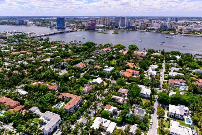 Viewed from above Midtown Palm Beach, the West Palm Beach skyline rises beyond the Intracoastal Waterway.
