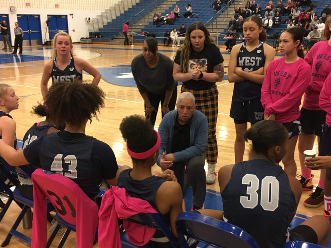 Pocono Mountain West coach Chrissy Campos, center, talks to the Panthers during a timeout during the District 11 Class 4A girls basketball quarterfinals on Feb. 21, 2020. PM West, PM East and Pleasant Valley plan to continue practice while East Stroudsburg South, ES North and Stroudsburg are not.