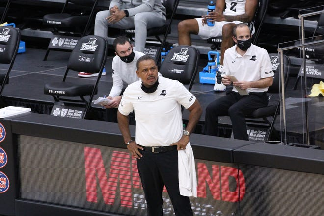 Ed Cooley acknowledged that he had trouble getting used to wearing a mask while coaching Wednesday but said he'll try to be better going forward.