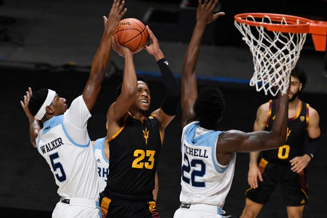 Arizona State's Marcus Bagley, center, goes up for a shot as Rhode Island's Antwan Walker, left, and Makhel Mitchell defend during the first half of Wednesday night's game in Uncasville, Conn.