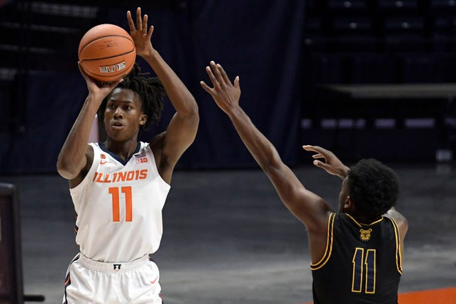 Illinois' Ayo Dosunmu (11) shoots as North Carolina's Tyler Maye (11) Wednesday, Nov. 25, 2020, in Champaign, Ill.