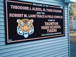 The sign in front of Theodore J Aleixo Jr. Tiger Stadium football field on the campus of Taunton High School.