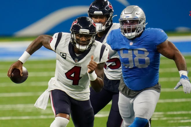 Houston quarterback Deshaun Watson is chased by Detroit defensive end Everson Griffen during Thursday's game.