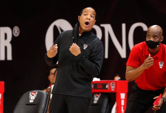Despite a game day unlike any other, N.C. State coach Kevin Keatts said it didn't take long for him to find his rhythm on the sidelines Wednesday night. (Ethan Hyman/The News & Observer via AP)