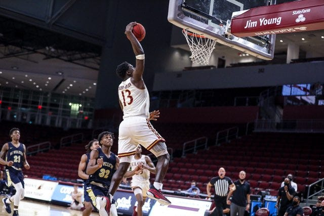 Elon's Jerald Gillens-Butler elevates to the rim for a dunk against North Carolina Wesleyan on Wednesday night.
