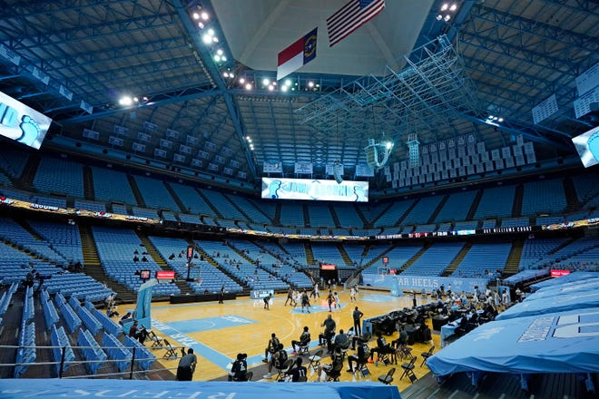 North Carolina and College of Charleston tip off their season-opening men's basketball game Wednesday night in a mostly empty Smith Center.