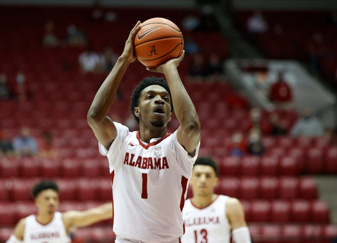 Alabama forward Herb Jones (1) shoots a free throw against Jacksonville State during the opening game of the season in Coleman Coliseum. [University of Alabama Photo by Kent Gidley]