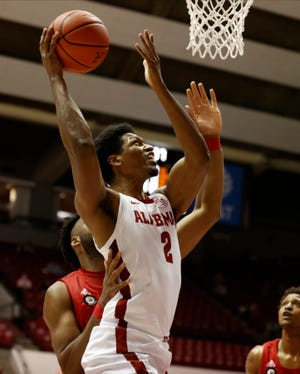 Alabama forward Jordan Bruner (2) takes the ball to the basket against Jacksonville State in the season opening game in Coleman Coliseum Wednesday night. [University of Alabama Photo by Kent Gidley]