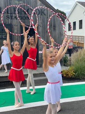 Nyah Baker, of Holbrook, (back, holding hoop, second from left) dances with other Candy Cases at a local venue as part of South Shore Ballet Theatre's film, The Nutcracker.""
