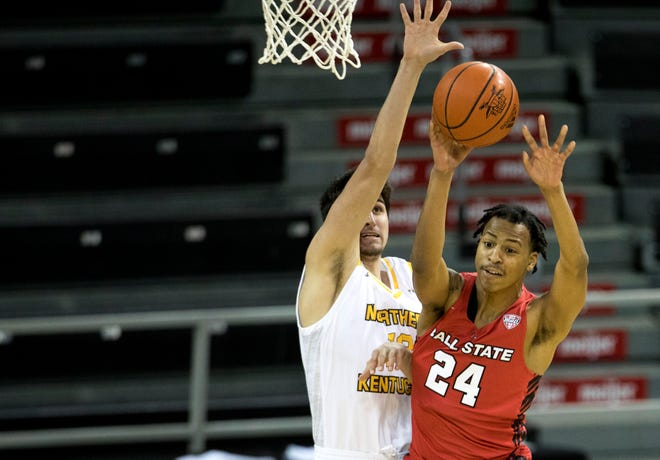 Ball State Cardinals guard Jalen Windham (24) passes as Northern Kentucky Norse forward David Bšhm (13) guards him in the second half of the NCAA men's basketball game between Northern Kentucky Norse and Ball State Cardinals on Wednesday, Nov. 25, 2020, at Northern Kentucky University in Highland Heights.