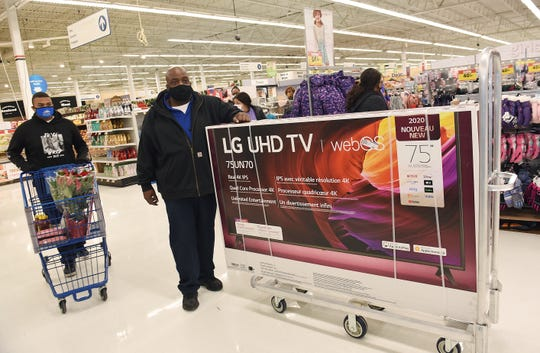 Jerome Stevenson of Detroit, with his son Jerome III, didn't have to wait in the checkout line for long at the Allen Park Meijer store on Thanksgiving day.