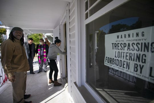 """Activists in March """"reclaimed"""" vacant houses owned by Caltrans to house people amid the coronavirus pandemic."""