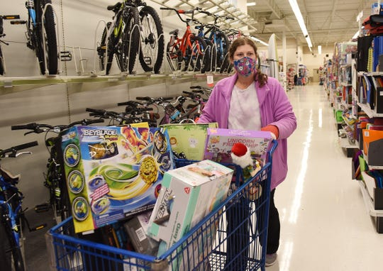 Jenny Fought of Dearborn Heights had the Meijer store in Allen Park largely to herself on Thanksgiving Day before it closed at 4 p.m.