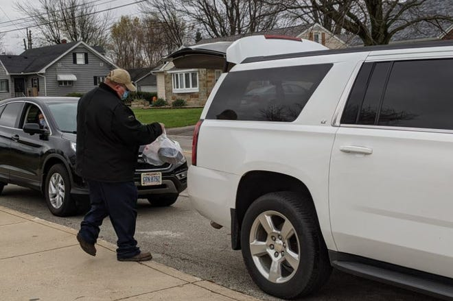 Meals were loaded into vehicles drive-thru style during the 2020 Free Community Thanksgiving Dinner in Elmore.
