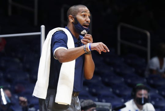 Butler Bulldogs head coach LaVall Jordan talks to a player at Hinkle Fieldhouse in Indianapolis, Wednesday, Nov. 25, 2020. Butler Bulldogs lead at halftime, 32-26.
