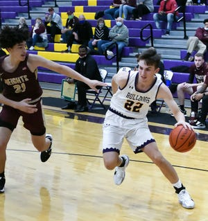 Bloom Carroll senior Monty Lobb drives toward the basket against Licking Heights' Dante Collier Wednesday night at Tom Petty gymnasium. B-C won 60-49.