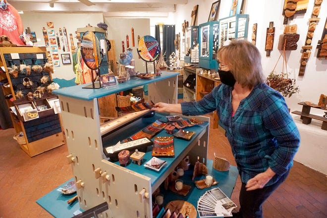 """Artist Janice Smith, owner of Laughing Spirits Gallery in Albuquerque's Old Town, gets ready for this weekend's virtual """"Arts Gone Viral"""" show presented by the Rio Grande Arts and Crafts, Tuesday, Nov. 24, 2020."""