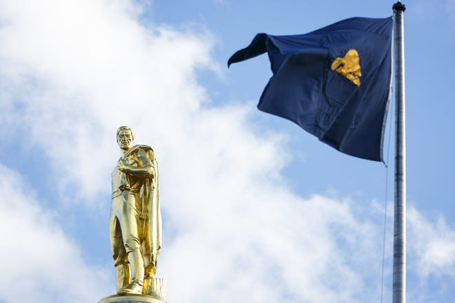 Blue skies light up the Capitol's Gold Man and Oregon flag on Jan. 22, 2017. Oregon is the only state to display different pictures on each side of the flag, with the reverse showing an image of a beaver.