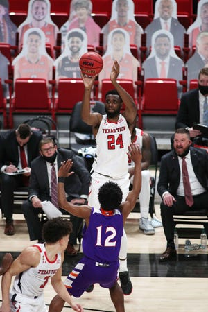 Texas Tech forward Joel Ntambwe (24) shoots over Northwestern State guard Carvell Teasett (12) during the Red Raiders' season-opening 101-58 victory Nov. 25 at United Supermarkets Arena. Tech announced Tuesday that Ntambwe has left the team. He redshirted last season and averaged 4.7 points in three games this season.