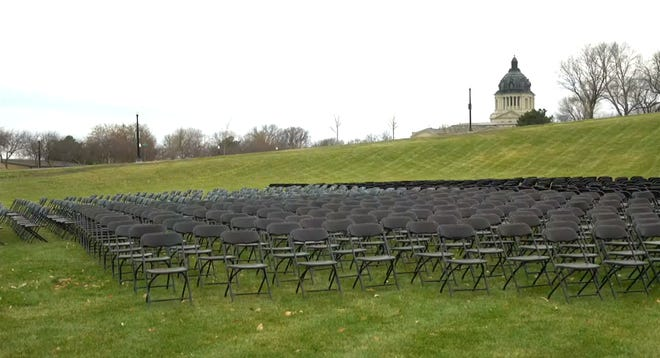 Hundreds of chairs sit on the grounds of the South Dakota State Capitol on Nov. 26, 2020.