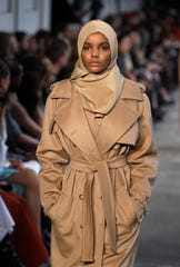 In this Feb. 23, 2017, file photo, Somali American model Halima Aden wears a creation part of the Max Mara women's Fall-Winter 2017-18 collection, that was presented in Milan, Italy.
