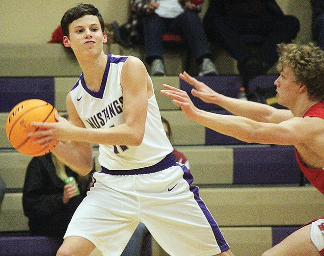 Clayton Holley, left, is one of two powerfully productive returnees for the Wesleyan Christian School boys basketball team.