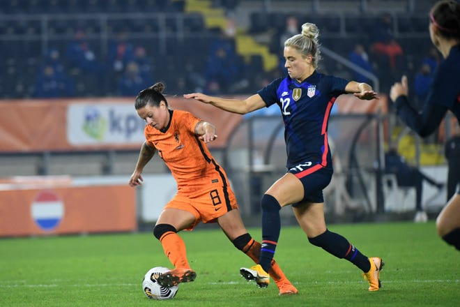 The Netherlands' Sherida Spitse, left, and Kristie Mewis of the United States vie for the ball during the international friendly match in Breda, southern Netherlands, Friday.