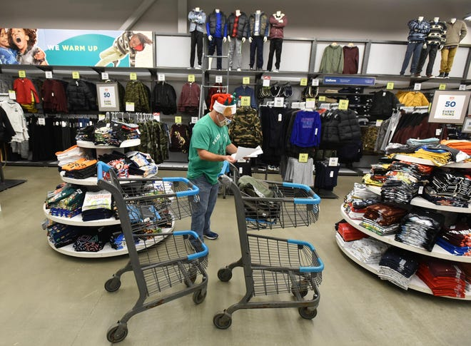 With two carts to fill and a long list, Jonathan Weisblatt starts his Black Friday at 4 a.m., shopping for the Homeless Prevention Council's Adopt-A-Family program.