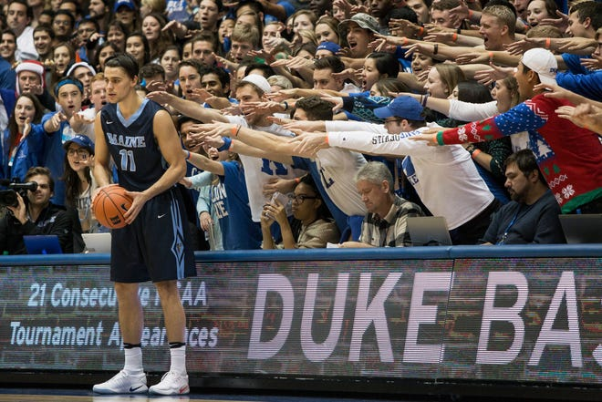 Maine's Ilija Stojiljkovic looks to in-bound the ball under pressure from the Cameron Crazies during a game at Duke in December 2016.